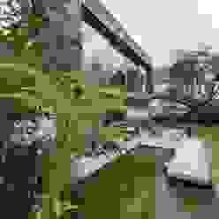 Blick auf die Gartenseite Moderne Häuser von GRIMM ARCHITEKTEN BDA Modern