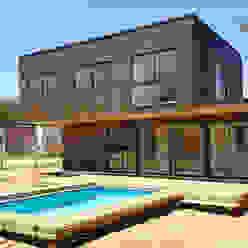 Fachada Casas de estilo mediterráneo de Lares Arquitectura Mediterráneo Madera Acabado en madera