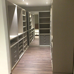 Remodelación vivienda en Versalles, CABA Vestidores y placares modernos de Inca Arquitectura Moderno Madera Acabado en madera