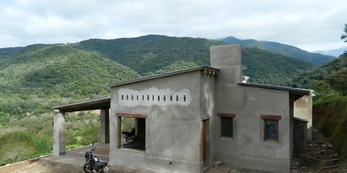 Casas de estilo  por FERRER||AGUIRRE ARQUITECTURA+DISEÑO+MUEBLES