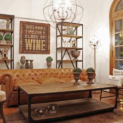 Living-room hierro y madera + chesterfield en cuero Estación Ortiz LivingsSofás y sillones