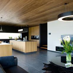 Ökologisches Massivholzhaus Maisons Loginter Moderne Wohnzimmer