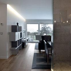 Iluminación espacio abierto con líneas de luz Taralux Iluminación, S.L. Salones de estilo ecléctico