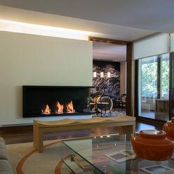 Vista del living hacia el comedor Thomas Löwenstein arquitecto Livings de estilo ecléctico Madera Multicolor