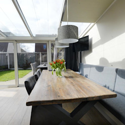 Foto 1 eetkamer/serre Anne-Carien Interieurarchitect Moderne eetkamers
