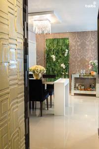 Jardim Vertical: Salas de jantar modernas por Talita - Fotografia de Arquitetura e Decoração