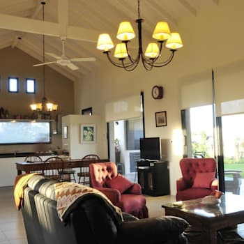 Salas / recibidores de estilo rural por Parrado Arquitectura