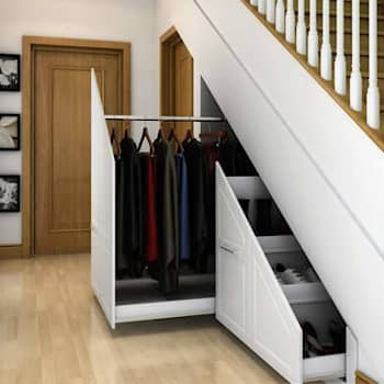 Innovative storage solutions.: modern Corridor, hallway & stairs by Charts Interiors