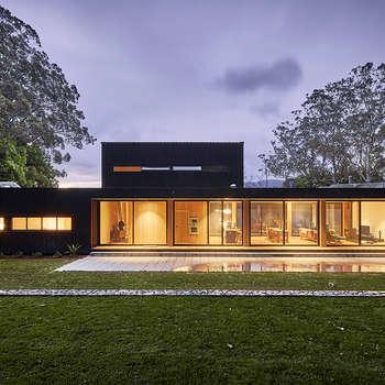 Casas de estilo minimalista de Modscape Pty Ltd