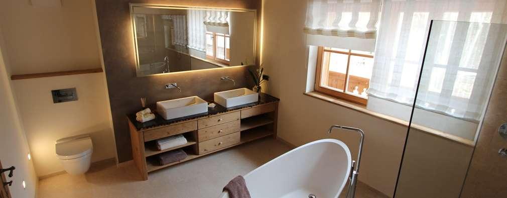 Luxuriöse Residenz in Top-Lage von Kitzbühel: landhausstil Badezimmer von Egger & Egger Immobilien