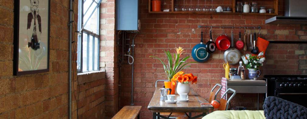 industrial Dining room by Cassidy Hughes Interior Design