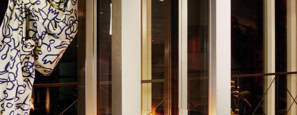 cheminée centrale:  de style  par Bloch Design
