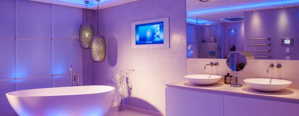 Baddesign für die Sinne aus Naturstein mit Lichtdesign der extraklasse Led RGB : ausgefallene Badezimmer von Design by Torsten Müller