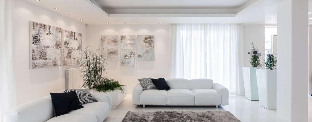 Salones de estilo minimalista de StudioG