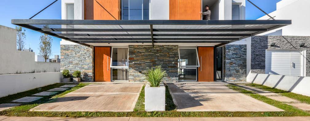 Casas de estilo moderno por Estudio A+3