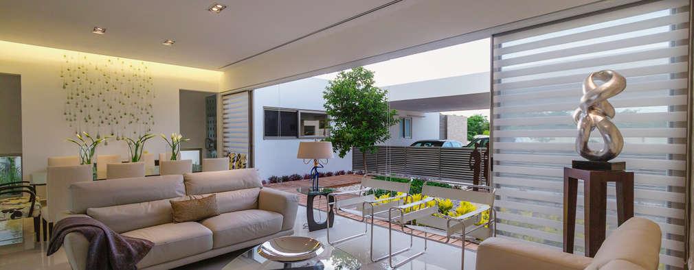 Salas / recibidores de estilo moderno por Grupo Arquidecture