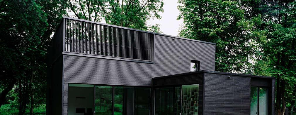 Casas de estilo minimalista por C95 ARCHITEKTEN