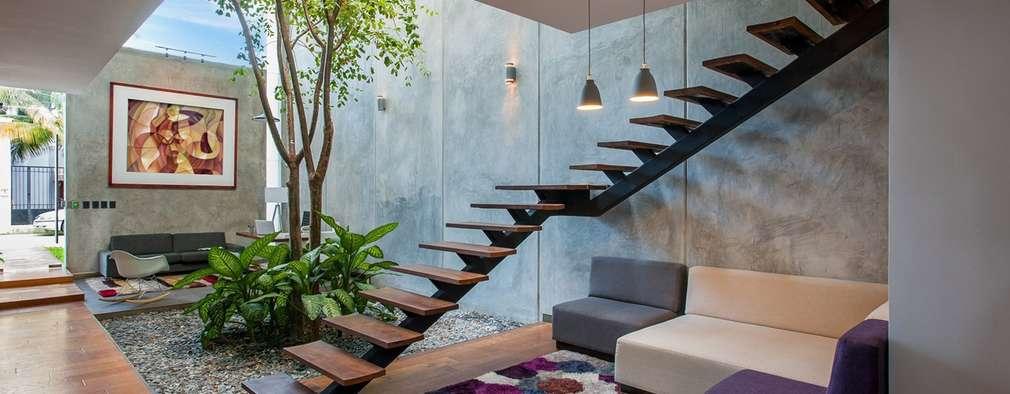 Oficinas y tiendas de estilo  por Desnivel Arquitectos