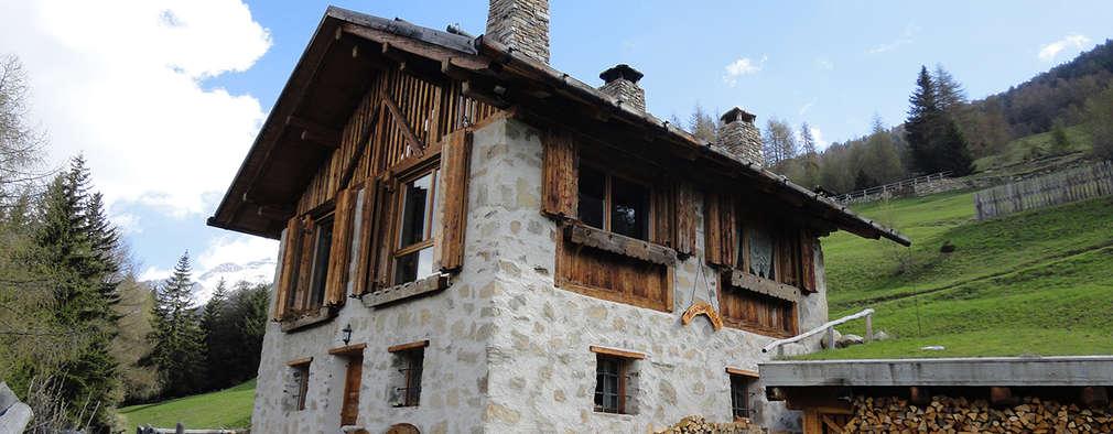 Casas de estilo rústico por zanella architettura