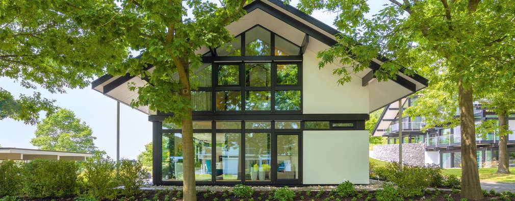 modern Houses by HUF HAUS GmbH u. Co. KG
