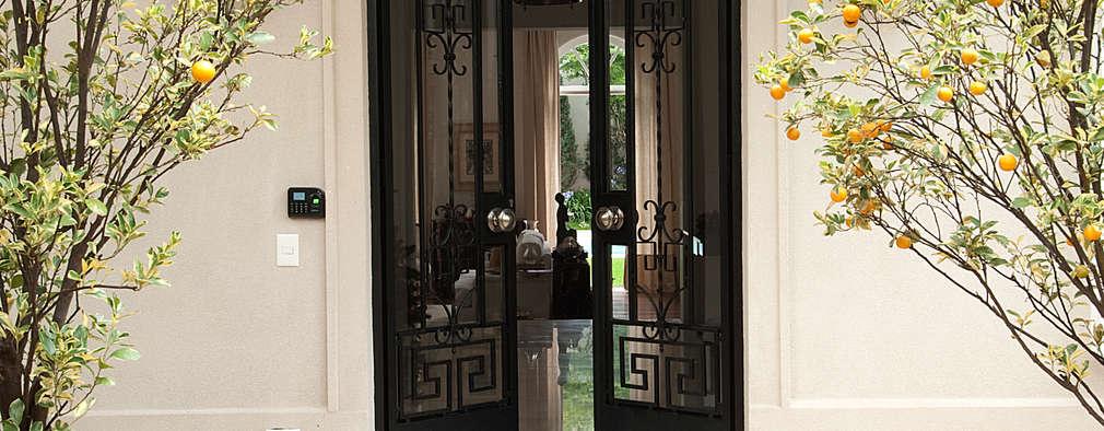 15 puertas de metal que har n lucir tu casa a n mejor for Puertas de metal con vidrio