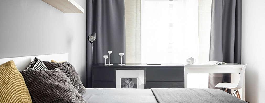 Dormitorios de estilo moderno por głodni STYLU pracownia projektowa
