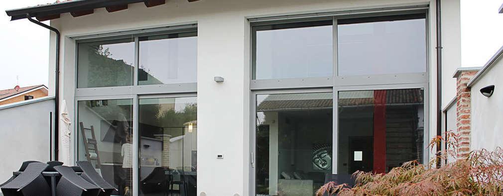 Casas de estilo moderno por Studio 06