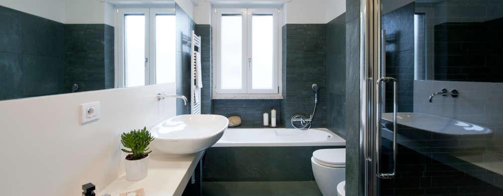 Appartamento ad Ostiense - Roma: Bagno in stile in stile Moderno di Archifacturing