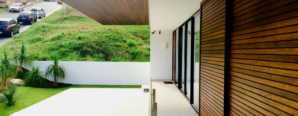房子 by JOBIM CARLEVARO arquitetos