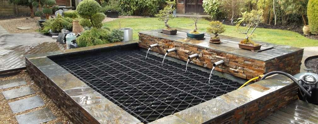 Jardines de estilo moderno por Aquajoy water gardens ltd