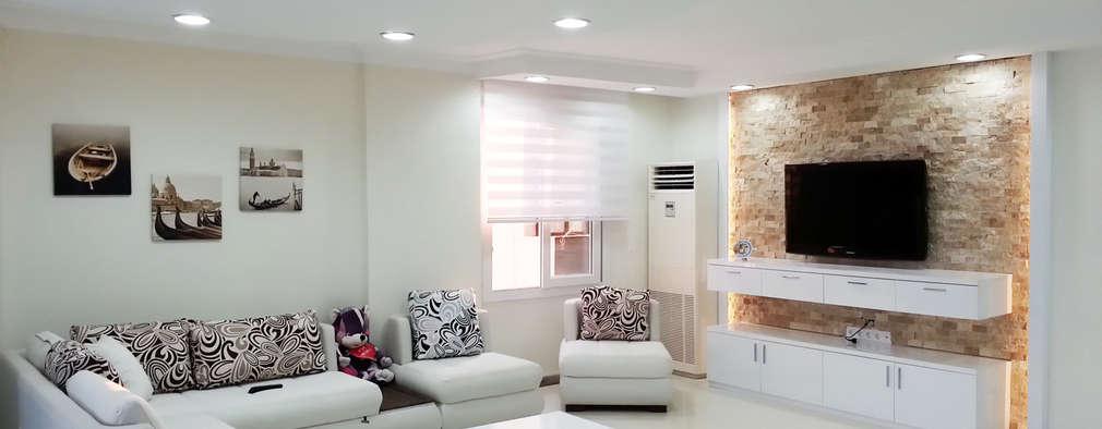 غرفة المعيشة تنفيذ Emre Urasoğlu İç Mimarlık Tasarım Ltd.Şti.