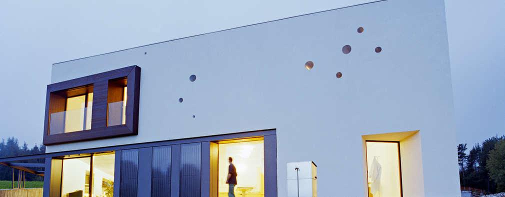 modern Houses by AllesWirdGut Architektur ZT GmbH