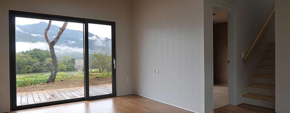 modern Living room by (주)오우재건축사사무소 OUJAE Architects
