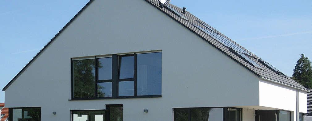 modern Houses by STRICK  Architekten + Ingenieure