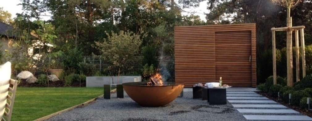 Design Gartenhaus Stahl mit Holzlattung:  Terrasse von Fellbacher Metall- und Holzbau GmbH