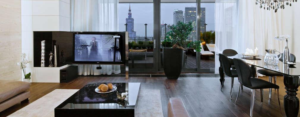 Salas de estilo ecléctico por living box