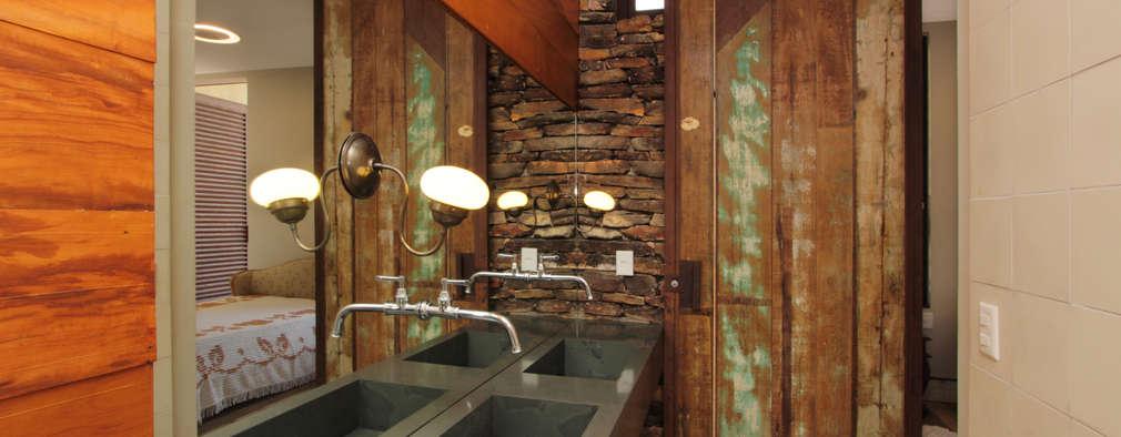 Baños de estilo rústico por COSTAVERAS ARQUITETOS