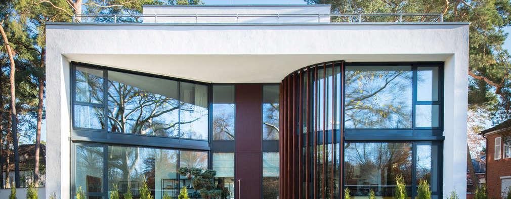 Maisons de style de style Moderne par FLOW.Generalunternehmer