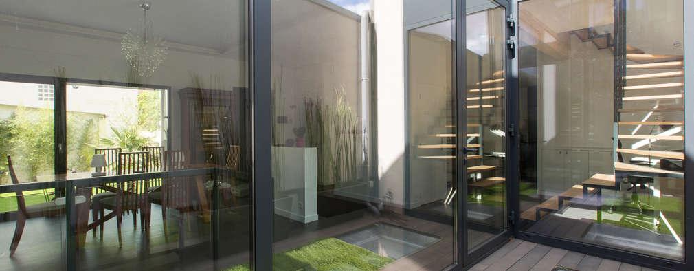 moderne Huizen door agence MGA architecte DPLG