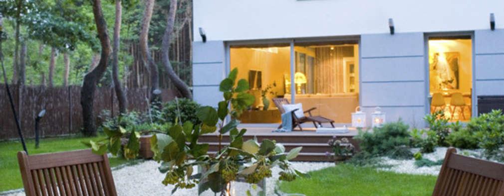 Dom pod Warszawą: styl minimalistyczne, w kategorii Domy zaprojektowany przez MAKAO home