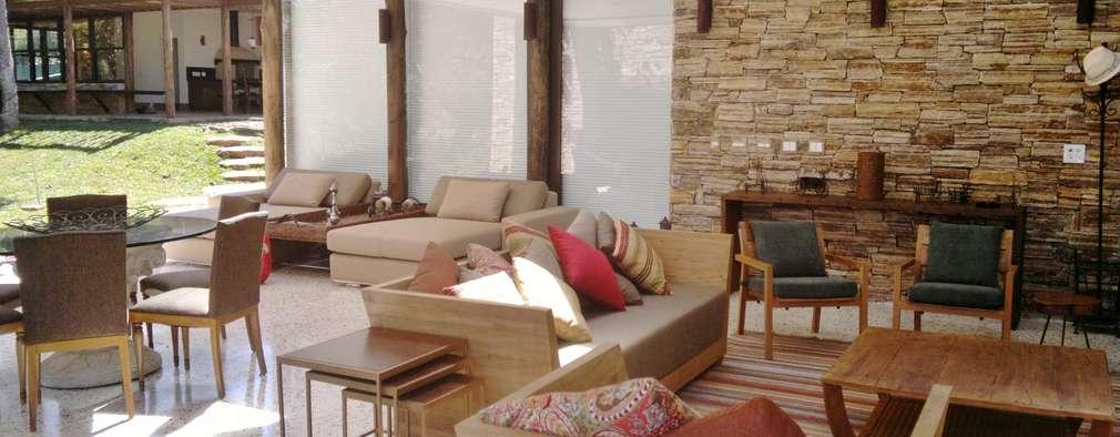 بلكونة أو شرفة تنفيذ Kika Prata Arquitetura e Interiores.