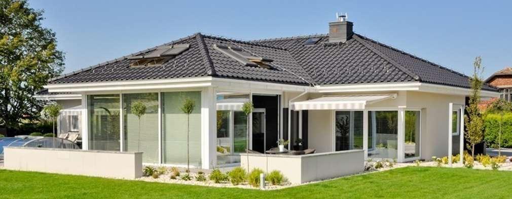 Dom w Amarantusach : styl , w kategorii Bungalow zaprojektowany przez Abakon sp. z o.o. spółka komandytowa