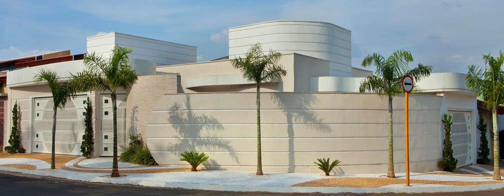 Projekty, nowoczesne Domy zaprojektowane przez Designer de Interiores e Paisagista Iara Kílaris
