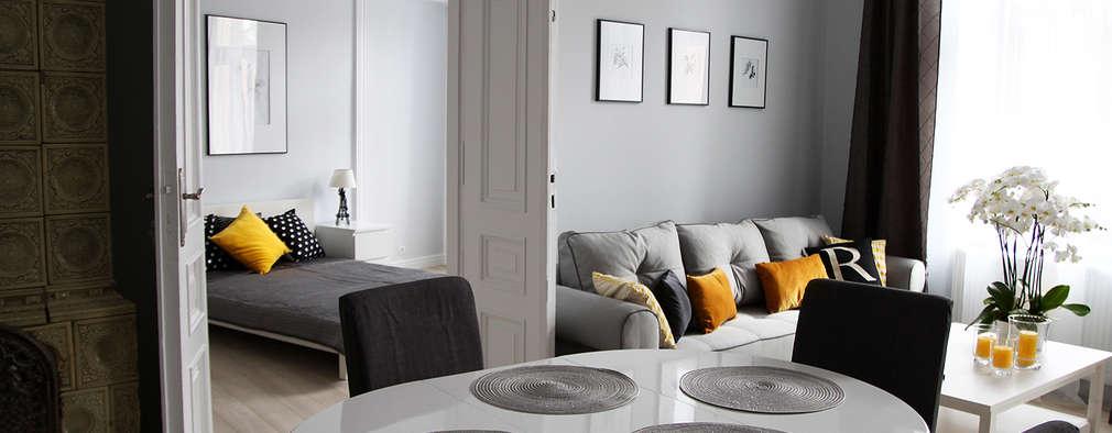 Comedores de estilo ecléctico por Grey shade interiors