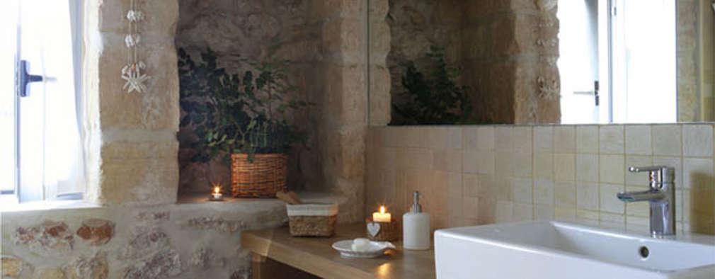 Baños de estilo rústico por Deu i Deu