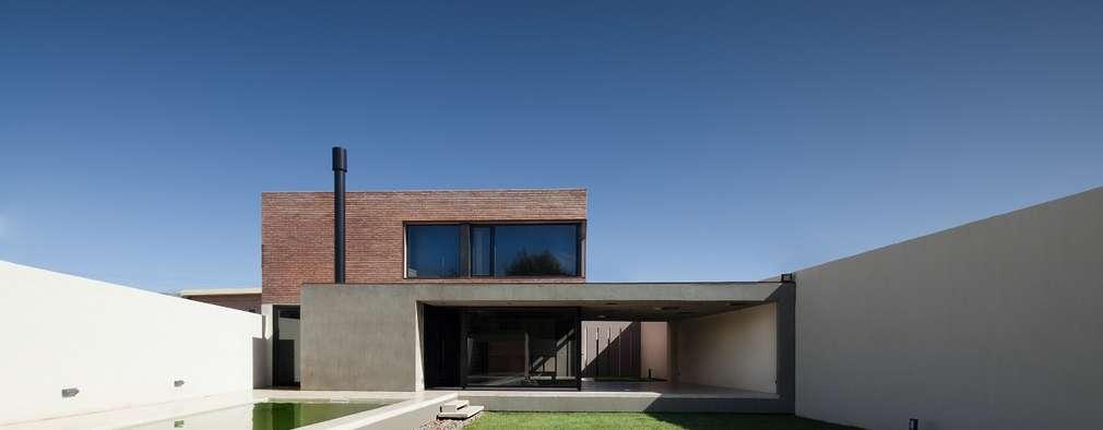 VIVIENDA UNIFAMILIAR K.G. : Casas de estilo moderno por DMS Arquitectura