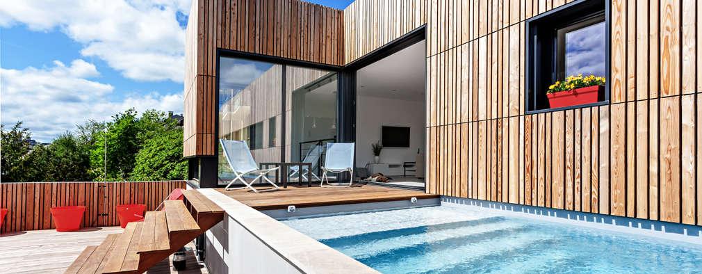 Albercas de estilo minimalista por Hugues TOURNIER Architecte