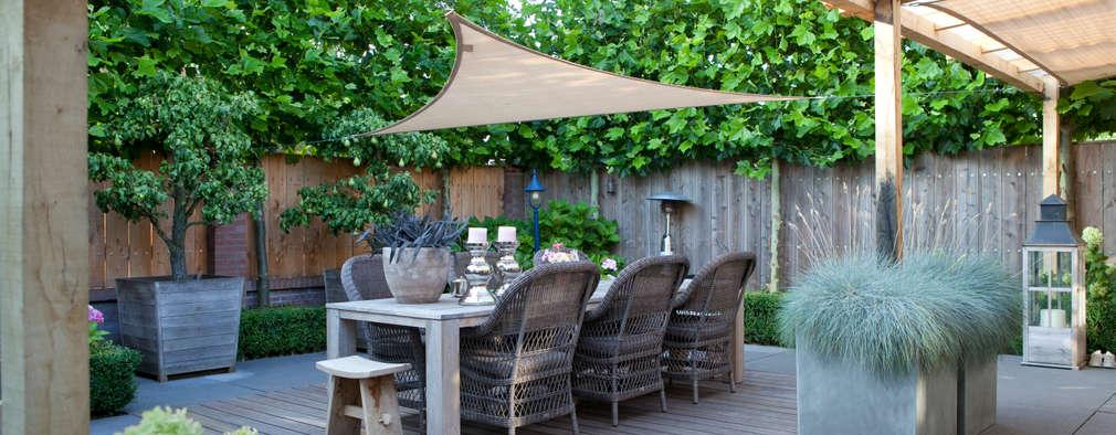 rustikaler Garten von Mocking Hoveniers
