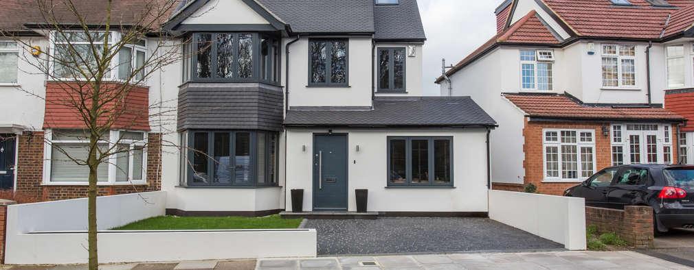 Nhà có sân thượng by GK Architects Ltd