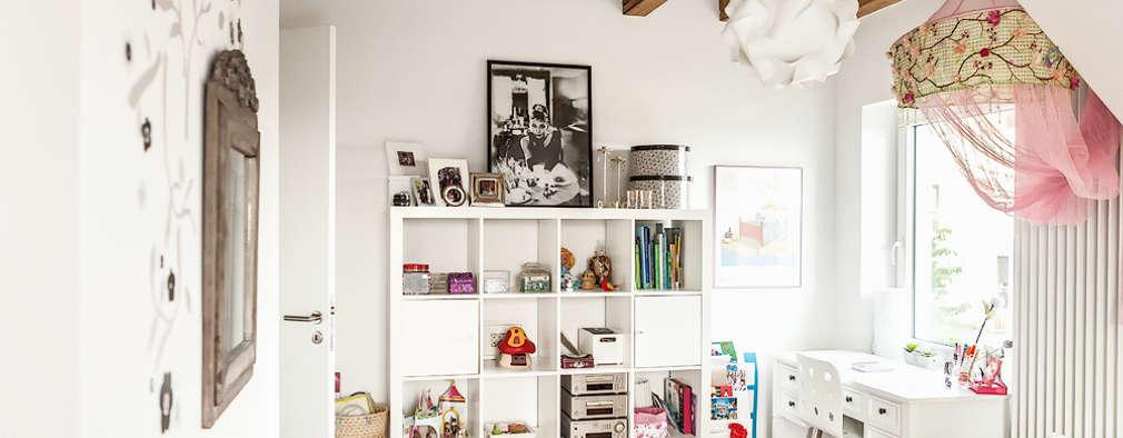 Alte Balken im Mädchenzimmer: ausgefallene Kinderzimmer von raumatmosphäre pantanella